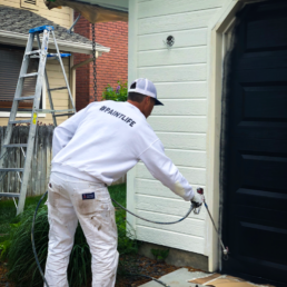 Painting brand new garage doors